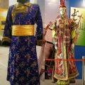 Buryat Mongolian dress deel (the square opening edges on the chest area) for a man (left) and an earlier dress deel for a woman (right) showing more elaborate design including taller hat.