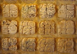 Mayans might have chosen any of these glyphs as their tattoo. Maya glyphs in stucco at the Museo de sitio in Palenque, Mexico