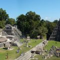 Temple I on The Great Plaza and North Acropolis seen from Temple II in Tikal, Guatemala. By Bjørn Christian Tørrissen [CC BY SA, 3.0], via Wikimedia Commons