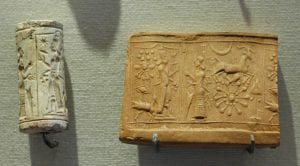 Mesopotamian limestone cylinder seal and impression—worship of Shamash, (Louvre), public domain, via Wikimedia Commons 13. Women in Mesopotamian Society